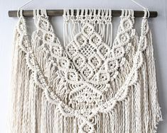 A modern patterned macrame design. The perfect amount of texture to add to a room, while keeping a clean, yet free spirited vibe. Great addition to any eclectic, mid-century modern, or boho inspired spaces/ events. -Hand-knotted using 100% natural (cream) Canadian cotton rope.