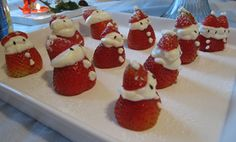 Santa Strawberries  Strawberries turned into Santa Clauses by my sister-in-law and the peanut. The siamese twins on the far right are my favorite. Note the black sesame seeds used as eyes.  ~ youthlarge blog
