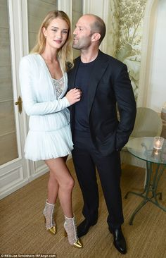 Jason Statham holds on tight to girlfriend Rosie Huntington-Whiteley as they put on a united front