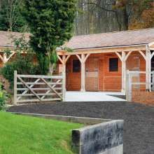 timber stables and landscaping