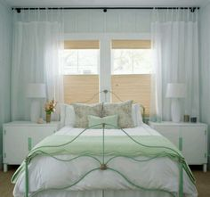 Styling a bed under a window - really like the crinkly shades