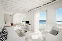 HOTEL CAVO TAGOO. Also small strokes of blue or red and sea views.