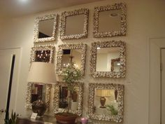 Oyster Shell Mirror - Currey & Company    On wall which is seen from from front door paired w/ mirrored or lucite console table or bar cart (see dimensions of space to confirm)