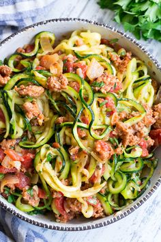 These zucchini noodles are made deliciously savory with lots of spicy Italian sausage and a creamy tomato sauce. Quick to throw together on a weeknight and easy to make ahead of time too! It's a filling family friendly lunch or dinner that's Paleo Wh Zoodle Recipes, Spiralizer Recipes, Pork Recipes, Paleo Recipes, Cooking Recipes, Creamy Tomato Sauce, Tomato Cream Sauces, Vegetable Noodles, Zucchini Noodles