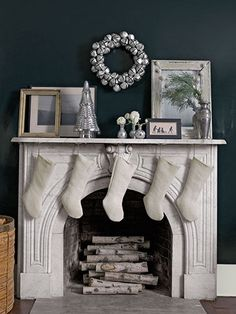 A jingle-bell wreath and mercury-glass tree dress up this marble mantel.