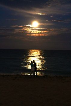 Moon over the Atlantic Ocean with Couples on North Miami Beach. Photo by Joshi