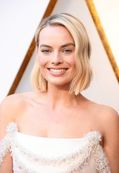 Margot Robbie Debuted Spring's Hottest Haircut at the 2018 Oscars | At the 2018 Oscars red carpet, Academy Award-nominated actress Margot Robbie debuted one of spring's hottest haircuts—a blunt bob. See pictures of it here.