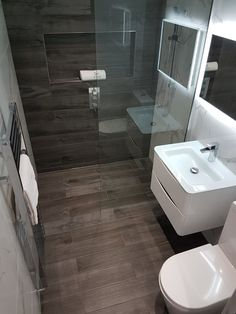 Compact wet room. Plank tiles, marble tiles, wall hung vanity & glass basin. Wetroom by Ultimate Wetrooms