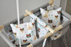 Hand-made and sewn swing chairs for babies and kids, applied from 6 month on. Made in Slovenia, Europe. The swing chair is sewn from 2 layers of cloth with an added pillow which supports the back of little babies, and wooden hoops for playing. It hangs on the 2 m rope, thickness 6 mm, which