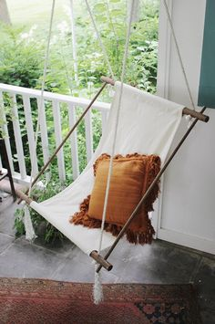 DIY a hanging lounge chair with some rope, doweling and cloth.
