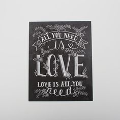 "This shabby-chic-style ""All You Need Is Love"" print features whimsical hand lettering with sweet, chalk flower illustrations. Frame as a gift or use it as great accent to your wedding day! - Matte arc"