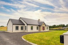 The site Keith and Romina McGreal chose to build on required an Environmental Impact Statement to secure planning permission. Simple Bungalow House Designs, Modern Bungalow, Cottage House Plans, Cottage Homes, House Designs Ireland, Dormer Bungalow, Bungalow Extensions, Cottage Extension, Bungalow Exterior