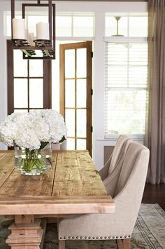 love everything about this room... chairs, table, floral arrangement, and light fixture