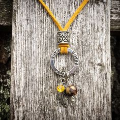 A personal favorite from my Etsy shop https://www.etsy.com/listing/231197380/yellow-suede-peace-neckace