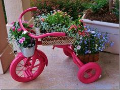 This project can, of course, be completed with any color you like. The one pictured above makes its presence known with a hot pink that's hard to keep your eyes from. Such a bright and bold color makes a great contrast if you've got greenery or more subtly colored flowers to plant. With an assortment of store bought baskets mounted on the frame, the tricycle becomes a handy, modifiable planter.
