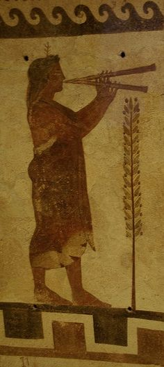 Etruscan terracotta plaque, male double-flute player - used to cover the walls of a tomb; this one depicts, circa 500-450 BC - at the Museum of Fine Arts, Boston