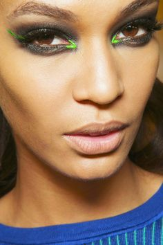 This eye make up is fierce. Neon liner in the corners. So cool.