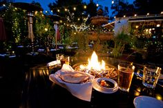 ZAYTOON in Santa Barbara.  Mediterranean food! Belly dancer entertainment! Not only is the food welcoming and homey, but the atmosphere and fire pits with family style tables makes dining an experience and not just eating!