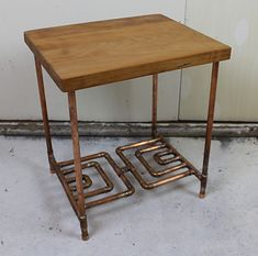 "Cherry & Copper Pipe Side Table by Paul Segedin & Urban Prairie Design, Chicago, Illinois. Table measures ~ 19""h x 17""w x 14""d and features unique, soldered copper pipe shelf. Table is available for $285."