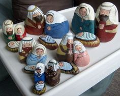 Unique #nativity sets painted on various sizes of rocks using acrylic paint in different color schemes.