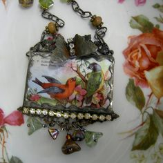 Soldered Glass Assemblage Charm Necklace  More by Vintagearts, $75.00