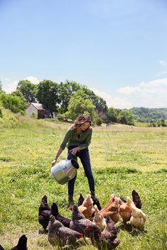 Photo Credit: Squire Fox. Jennifer feeding the chickens.