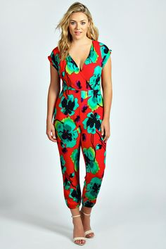 boohoo Tanya Floral Wrap Front Jumpsuit - red by: boohoo @boohoo (US) Get your #floral fix in this fierce #jumpsuit with sporty fitted cuffs. Style it with heels ; a #holographic clutch and bold lip .