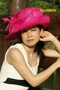 Hot Pink fuchsia wide brim Hat with Sinamay Leaves Flower and Long Stripped Ostrich  Spine.Ideal for church and kentucky derby.  42.00 4a0a0c739922