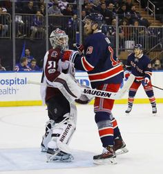 NEW YORK, NY - FEBRUARY 11: Calvin Pickard #31 of the Colorado Avalanche tries to block the view from Kevin Hayes #13 of the New York Rangers during the second period at Madison Square Garden on February 11, 2017 in New York City. (Photo by Bruce Bennett/Getty Images)