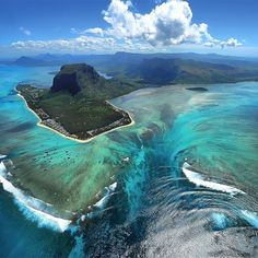 Mauritius, Indian Ocean. On the Southwestern point of Mauritius is a crazy looking phenomenon. When viewed from the air it appears to be an underwater waterfall!