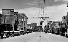 Avenida Rizal, Post WWII street scene, Manila, Philippines, Aug. 1945. In the distance on the left is a Grand Theater sign painted high on the building, on the right is Ideal Theater.