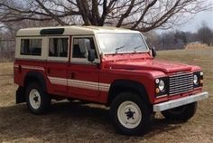 Land Rover Defender 110 Tdi Sw Se County in red.