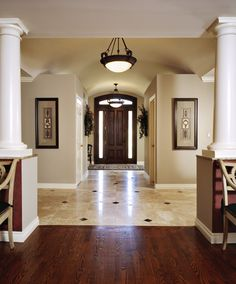 A Dramatic change to a 50's ranch was achieved with an addition and remodel of the foyer. Guests are welcomed with a distinctive mosaic floor of limestone and dark brown emperador marble from Virginia Tile. Photo by Beth Singer.