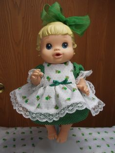 Faithie Grace in her green dress with white  pinafore
