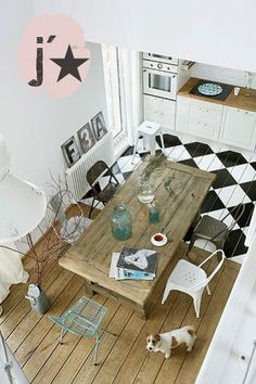 Wood table and floor, like the contrast with black and white floor
