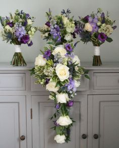 Delphinium brides shower bouquet and bridesmaids handties. contact The Stockbridge Flower Company fro more details.