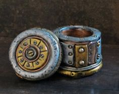 This Unique Steampunk Business Card Holder Is SuperSculpy sculpted and painted to look like worn, beat up metal, with a story to tell. Each one is individually created, so no two are alike. Add a touch of Steampunk to your office