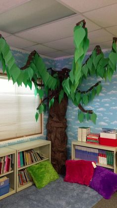 "Tree idea for Reading Area, tent... Options: attach some of the branches to the ceiling /or drape thin blue cloth for sky/night sky. Add white Christmas lights to the ""sky"" i.e. on the hanging fabric or wall ceiling."