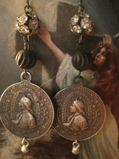 Honor -- Joan of Arc antique religious medal rhinestone earrings. $129.00, via Etsy.