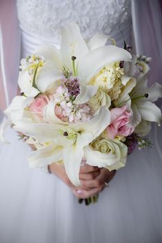 Lindsey's Bouquet!  #lilies and #roses.  Stunning! Pixel This Photography