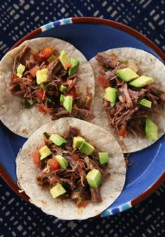 Slow-cooked, shredded beef brisket is tossed with lime, chiles, herbs, and cheese, then topped with avocado for an incredible taco filling.