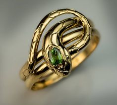 Antique Demantoid Gold Snake Ring | From a unique collection of vintage more rings at https://www.1stdibs.com/jewelry/rings/more-rings/ #GoldJewelleryUnique