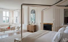 The master bedroom's custom-made four-poster was inspired by a '70s design by Maria Pergay, and the Jean Royère sofa beneath the window is covered in a mohair by Dedar; the '60s Pierre Paulin lounge chair is upholstered in an Edelman leather. Couturier