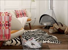 Tips, Zebra Pattern Carpet On Rustic Wood Floor Combine With Twin Fashionable Armchairs Applied In Small Relaxing Room That Equipped Withmalm Fireplace Concepts 047: Warm the Atmosphere in Your Home during the winter, With Fashionable yet Useful Fireplace