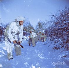 Men of 1st Glasgow Highlanders, 52nd (Lowland) Division wearing winter camouflage on a patrol near Gangelt in Germany, 10 January 1945.