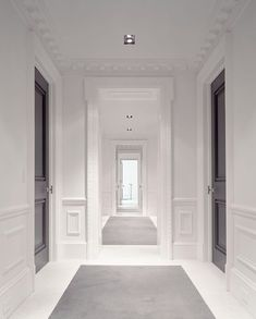 This is the ideal vision to transform the Second floor hallway.  Lacquered doors, moldings, recessed lighting, wall panels.