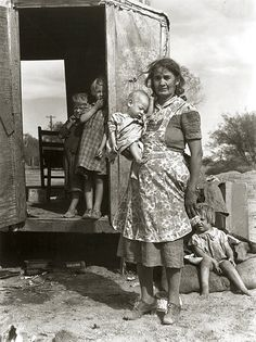 Depression era photo by Dorothea Lange.  She looks like she is utterly drained & kids look hopeless:(
