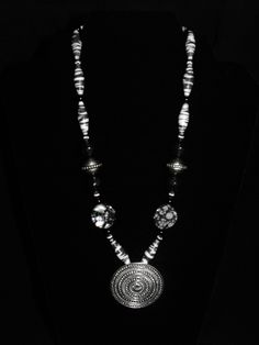 Black and white beauty from Paper Pearls Jewelry. I made these paper beads from a zebra print.  Accented with shell, glass and metal beads.  Medallion is solid metal with a raised texture. $23.00