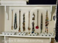 Jewelry organized in linen closet - ceramic egg containers :: OrganizingMadeFun.com