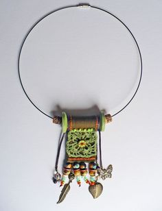 Interesting use of a spool. Textile Jewelry, Fabric Jewelry, Ethnic Jewelry, Bohemian Jewelry, Pendant Jewelry, Jewelry Art, Jewelry Necklaces, Bracelets, Handmade Necklaces